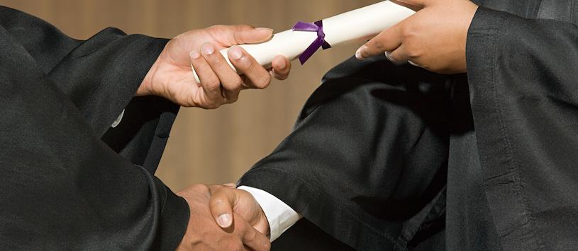 A graduate receiving their diploma.