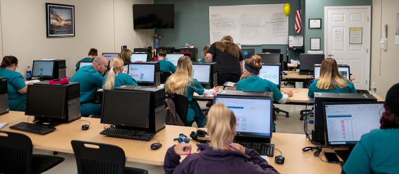 Valley College students learning in a computer lab.