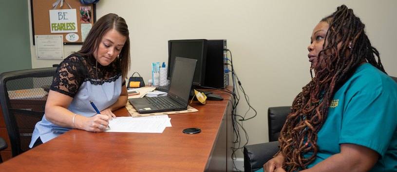 Valley College student having a meeting with a staff member.