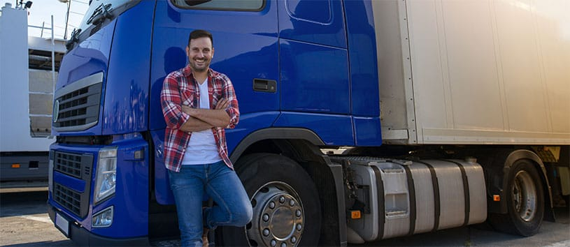 Man standing in front of a semi-truck.
